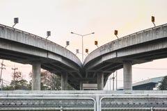 Cross bridge in twilight. Cross bridge across the highway in twilight stock photo