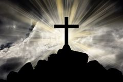 Cross with bright sun and dark clouds. Jesus cross with bright sun and dark clouds background Royalty Free Stock Photo