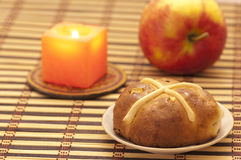 Cross bun with raisin and dried apricots Royalty Free Stock Images