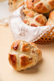 Cross buns and basket with a white napkin Stock Photos