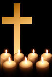 Cross and burning candle 2 Royalty Free Stock Photos