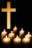 Cross and burning candle Stock Photo