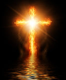 Cross burning in fire. In water Royalty Free Stock Photography