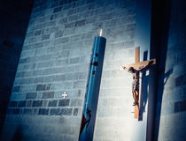 Cross and candle in church Stock Photos