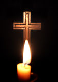 Cross and candles. Over dark background Stock Images
