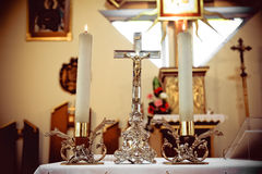 Cross and candles. In a church Royalty Free Stock Photography