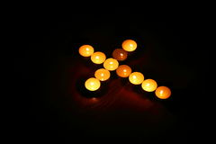 Cross of candles Royalty Free Stock Image