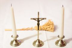 Cross and candles on a white tablecloth. Carol singing, cross an. D candles on a white table. Holiday time Stock Image