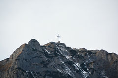 Cross on  Caraiman peak on Bucegi mountains. Caraiman cross was built between 1926-1928 and is the largest monument in the world at the highest altitude Royalty Free Stock Photography
