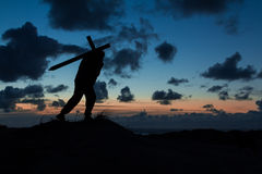 Cross Carrier. Man carrying a cross at dusk Stock Images