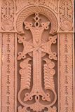 Cross carved on red stone - armenian church. Cross carved on red stone in armenian church stock photography