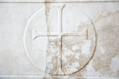 Cross carved in white marble Stock Photos
