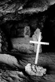 Cross on a cave royalty free stock photography