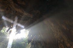 Cross in cave Stock Images