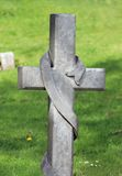 Cross in cemetery Royalty Free Stock Images