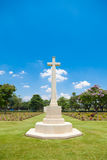 Cross in the cemetery Royalty Free Stock Image