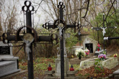 Cross in the cemetery. Old iron cross in cemetery Royalty Free Stock Photo