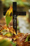 Cross in the cemetery. Old cross on one of the graves Royalty Free Stock Photography