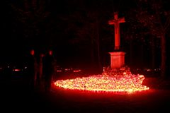 Cross on cemetery. In Vukovar illuminated with red candles stock photo
