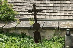 Cross at the cemetery wall Royalty Free Stock Photos
