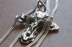 Cross and chain. Orthodox cross (crucifix Royalty Free Stock Photos