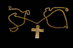 Cross on a chain on a black background Stock Images