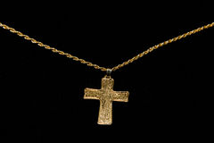 Cross on a chain on a black background Stock Photo