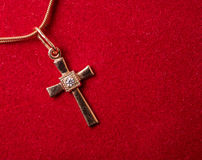 Cross on a chain Stock Image