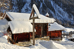 Cross, chalet and chapel stock photography