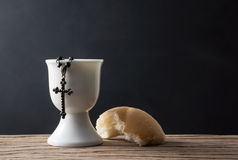 Cross in chalice with bread Stock Photos