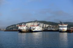 Cross Channel ferry ships in the Port of Dover, UK. View of three vehicle and passenger ferries docked at Dover on the British coast of the English Channel. The Royalty Free Stock Photography