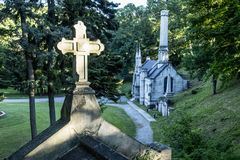 Cross, Chapel, Crematorium at Mt. Hope Cemetery. A sunlit cross and the original Chapel and Crematorium at the the historic Mount Hope Cemetery in Rochester, New Stock Images