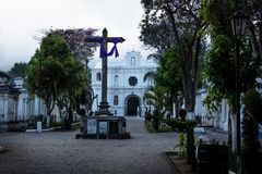 Cross and chapel at the San Lazaro Cemetery, Antigua, Guatemala. Cross and chapel at the San Lazaro Cemetery in dusk, Antigua, Guatemala royalty free stock image