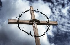 A cross with Christ and barbed wire royalty free stock photography