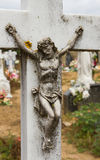 Cross with Christ in a cemetery Royalty Free Stock Photo