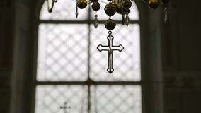 Cross in the church against the backdrop of light. Slow motion camera.  stock video
