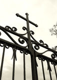 Cross on church gate, silhouette Stock Photography