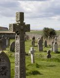 Cross in church graveyard. Detailed celtic style cross overlooking church cemetary near to the coast stock image