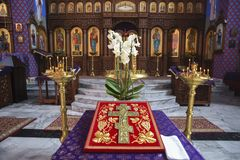 A cross in the church with an iconostasis in the background.  stock photography