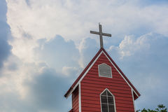 Cross church with red building and blue sky | Christian religion place and symbol Stock Photos