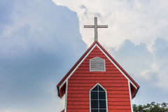 Cross church with red building and blue sky | Christian religion place and symbol Stock Photography