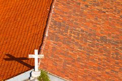 Cross on the church rooftop Stock Photo