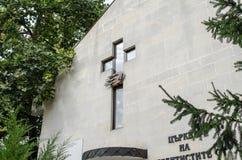 Cross of church on wall Stock Photos