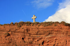 Cross on a cliff Stock Image