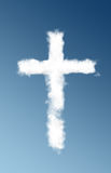 A Cross cloud. A cloud forming a giant cross against a blue background Stock Photos