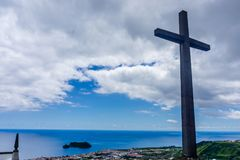 The Cross with clouds in the background. Azores Royalty Free Stock Image