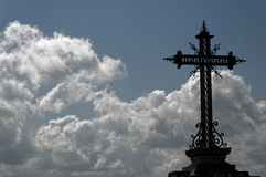 Cross and clouds. An iron cross with background of sky and clouds in Córdoba (Spain Royalty Free Stock Images