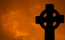 Cross with clouds at Sunset Royalty Free Stock Photos