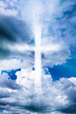 Cross in the cloudy sky. Cross in the sky among cumulus clouds Stock Photo