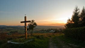 Cross and a colorful sunset Stock Images